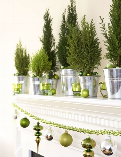 {The mini evergreens' metallic containers create a woodland theme, reflecting all of the green details. From:  Good Housekeeping .}