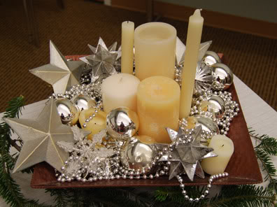 {Cream candles of various sizes grouped together to make a big impact.From:  April Force Pardoe Interiors .}