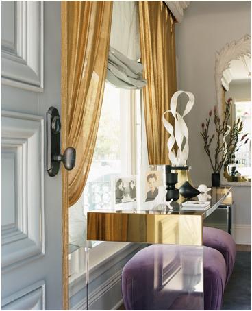{Stunning gold drapery panels.}
