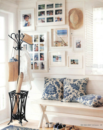 {Personal touches are a great welcome to any home. These family photos make this entryway unique. By  Mochatini .}