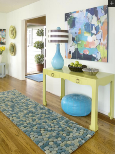 {I expect to have some fun in this house! A bold color palette creates a lively entryway. By  Green Box Art .}
