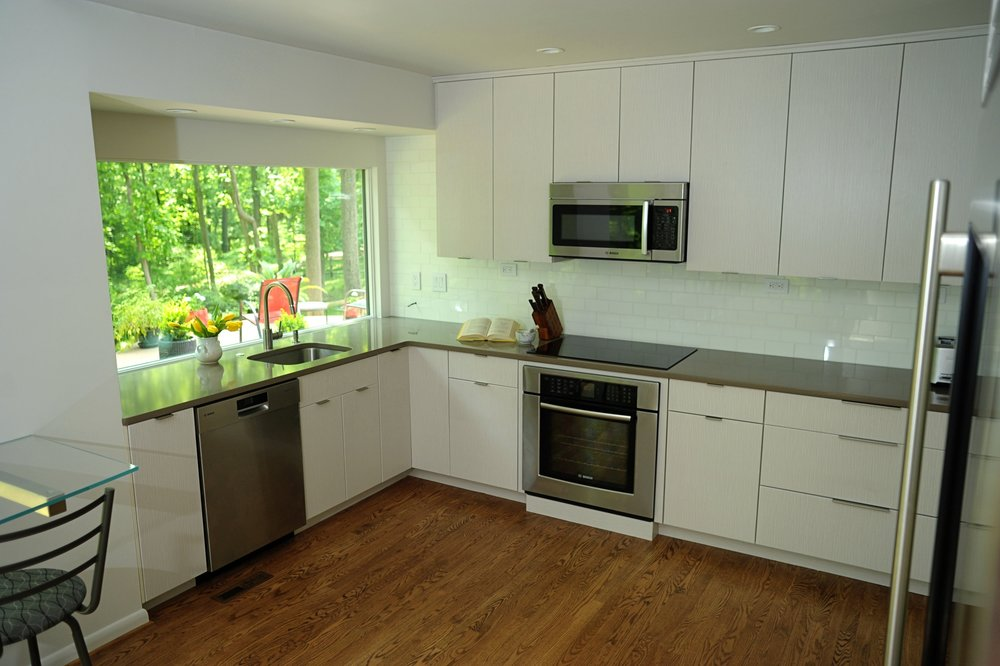 {The cabinets, countertops and new appliances are in as this kitchen renovation moves along!}