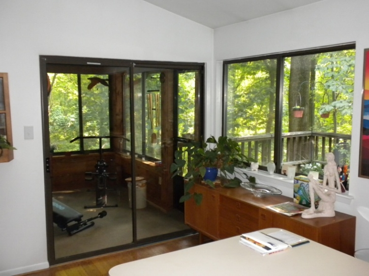 {Before, kitchen window with a sideboard below.}