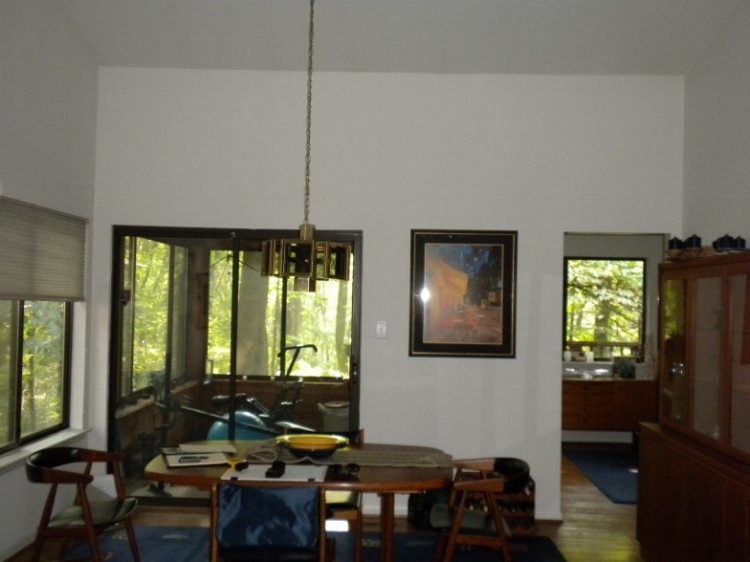 {Before, a snapshot of sun room with lots of wood.}