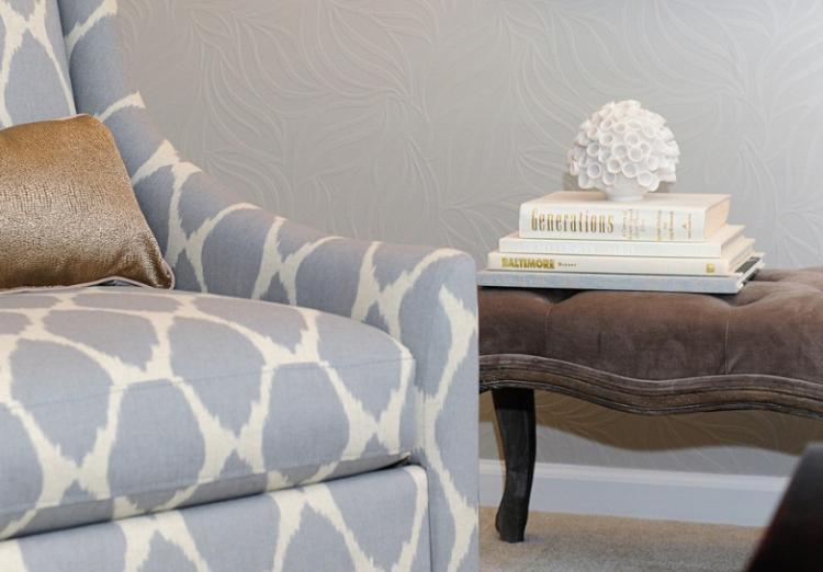 {Painted wallpaper adds texture to the living room space.}