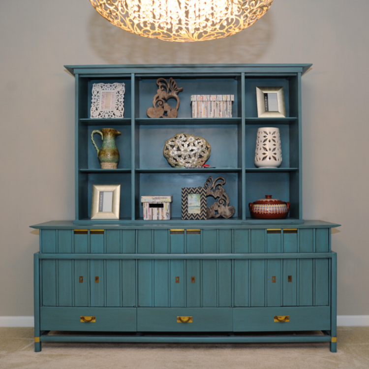{A custom transformation by Lenehan Studios. This cabinet is the statement piece in this condo design.}