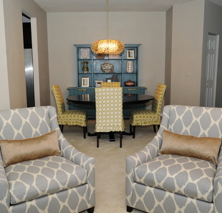 {After:  A stylish and sophisticated living and dining room designed for a young couple.}