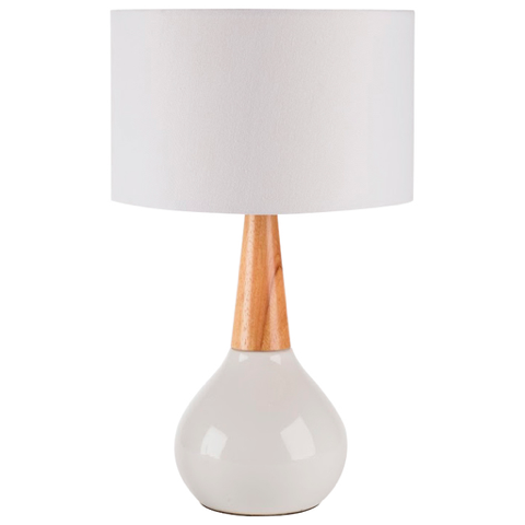 {A mid-century style table lamp in a neutral palette that doesn't compete with our bold color selections. From:  Surya. }
