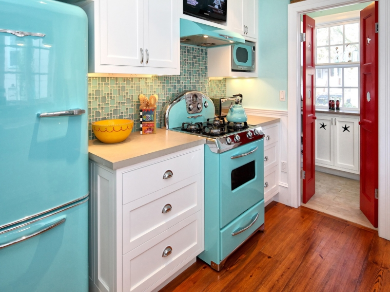 {Not afraid of color? These robin's egg blue appliances make a sensational statement. The red doors are a nice contrast, too. From:  Knight Architects .}