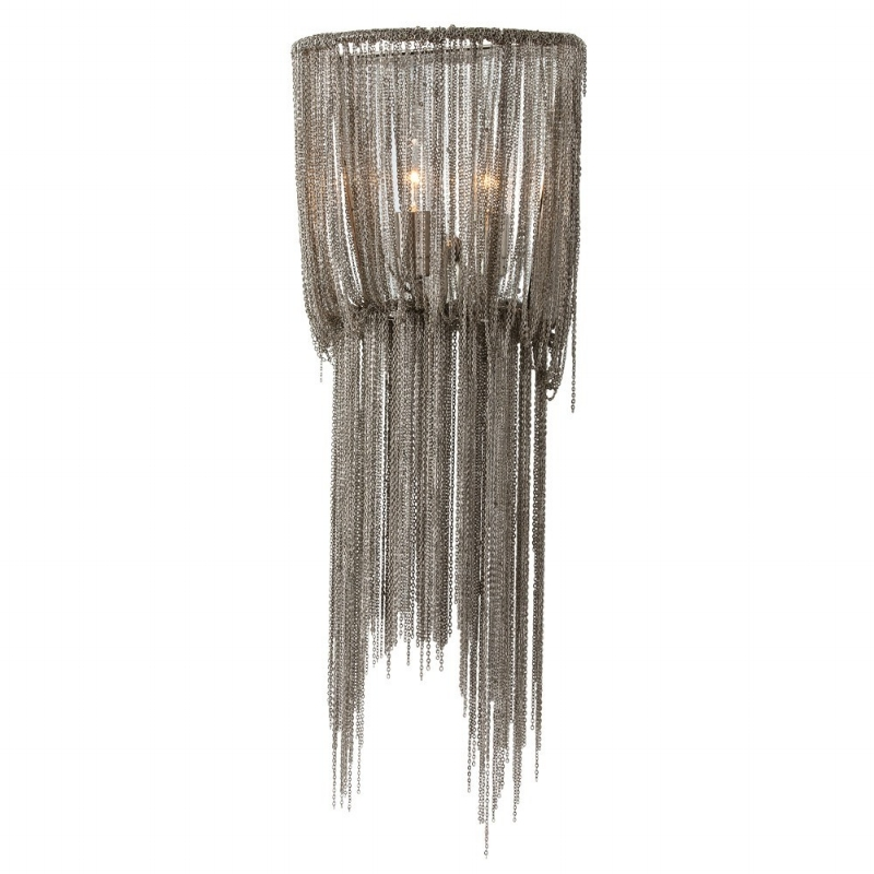 {The brass chains remind me of a high glamour dress with tassels circa the 1920s. From  Arteriors Home .}