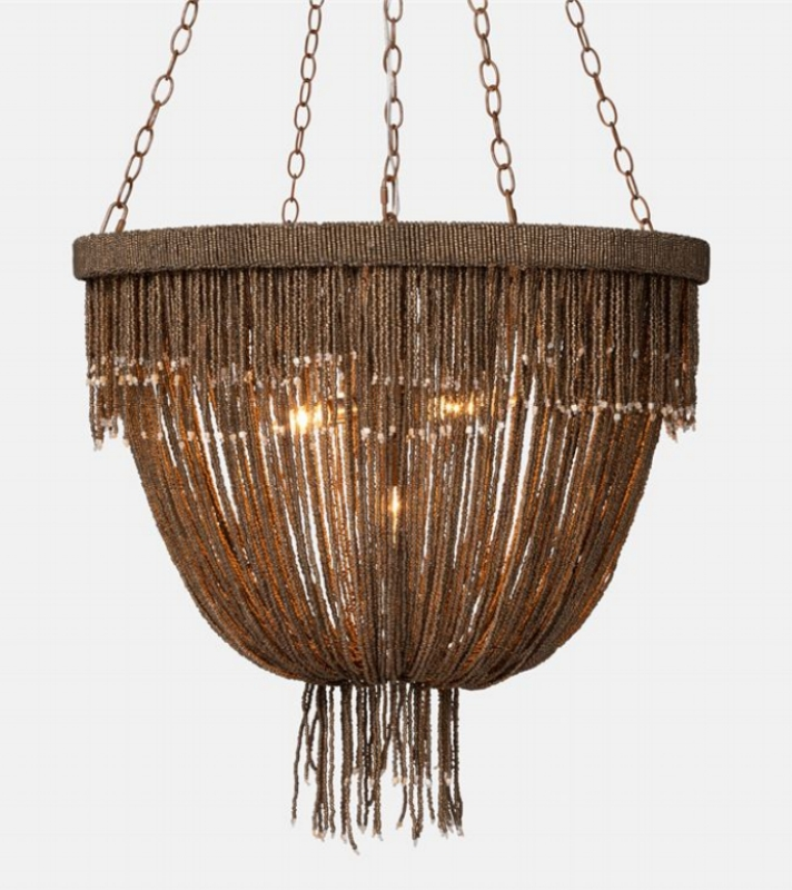 {This beaded fringe chandelier will sure add sophisticated drama to any space. From:  Made Goods .}