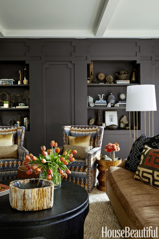 {This living space is wrapped in warm, black-brown walls. From:  House Beautiful .}