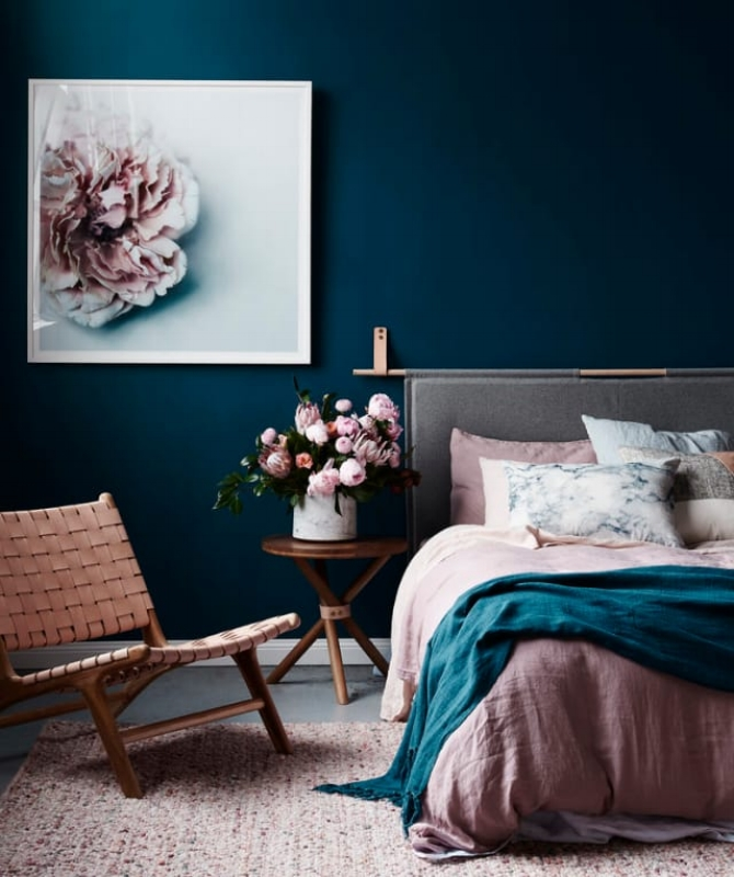 {These navy blue walls are stunning with soft pink accents in this bedroom. From:  Adore Home Magazine .}