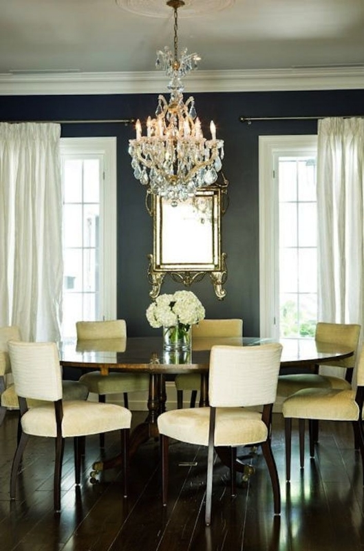 {This dining room is cozy yet bright with the contrast between of dark grey walls and white drapes and upholstered chairs. From:  Gorgeous Shiny Things .}