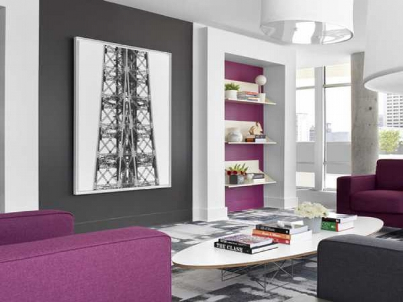 {This plum and grey living space is sleek yet soothing. From:  Lush Home .}