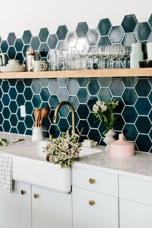 {If the white outlet covers blended in with the hexagon tiles they would not stand out as much and break the flow of the gorgeous backsplash. A decorative artist could make these covers disappear! From:  Domino .}