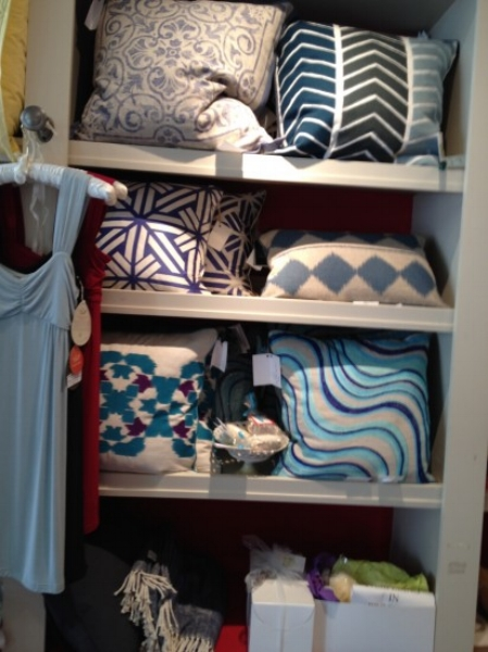 {Toss pillows fill this display area – ready for you to create a new look in your home.}