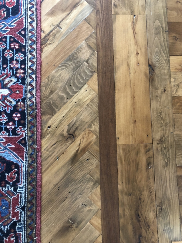 {There is character every which-way you look in Mary's house, including the way the (up-cycled) floor boards were laid.}