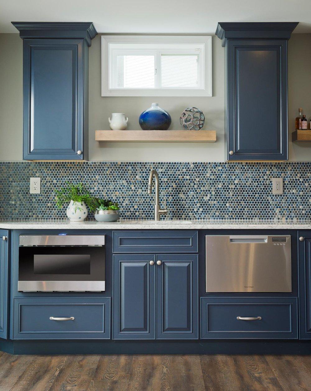 Kitchen counter with sink blue tiled backsplash