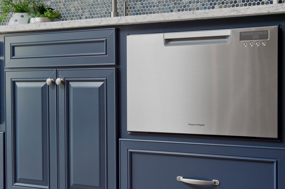 Blue cabinets and stainless steal dish washer
