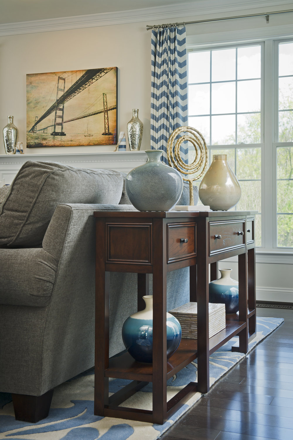 {A sofa table is a great place to create new displays after your holiday decor comes down. Design by April Force Pardoe Interiors – Photo by Vince Lupo.}
