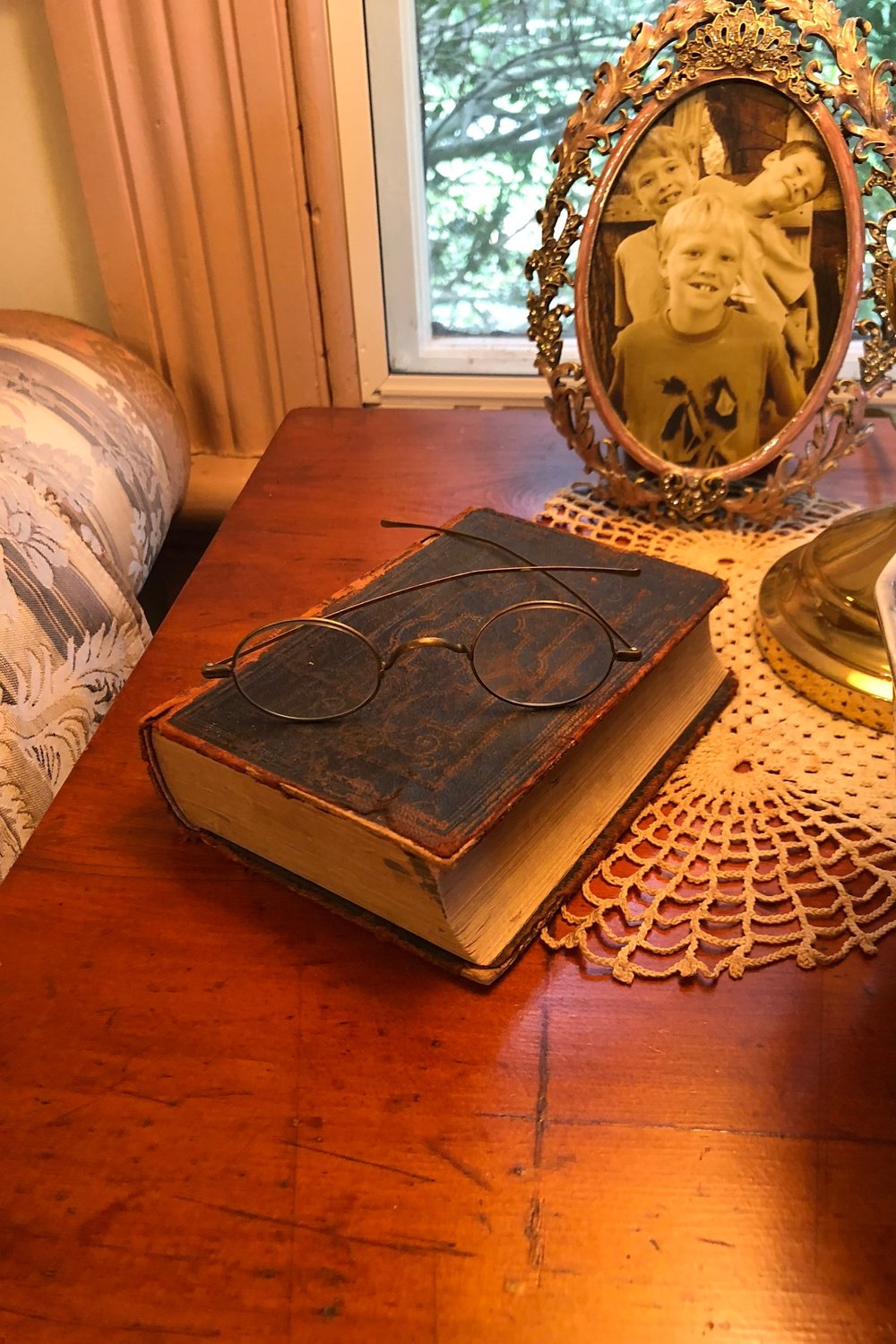 {Pat's grandfather's Bible makes for a unique end table accessory!}