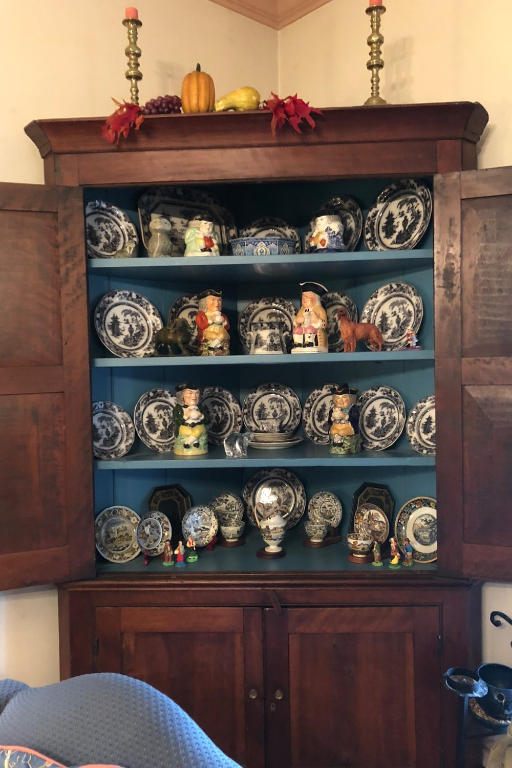 {A gorgeous piece, this corner cabinet shows off some of Pat's antique China.}