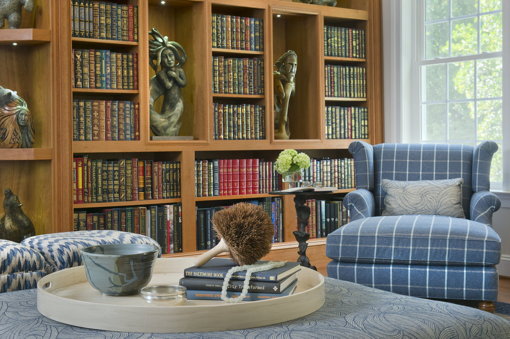 {This custom bookcase was designed to show off the clients Inuit art collection. Proper lighting was key and we consulted with the Smithsonian to ensure we have the proper type of lighting to enhance these stone sculptures!  Bluebell Way  design by April Force Pardoe Interiors.}