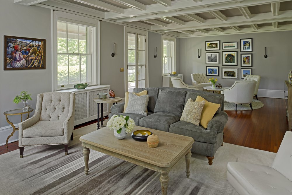 {This long family room has two seating areas, both great for conversation!  Overhill Road  design by April Force Pardoe Interiors.}