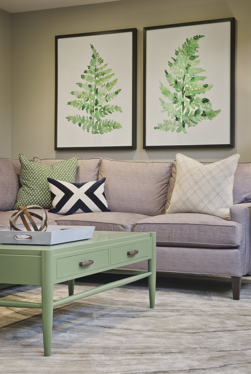 {What's your favorite piece in the finished space? We're torn between the custom-made coffee table and the oversized fern leaf prints.}
