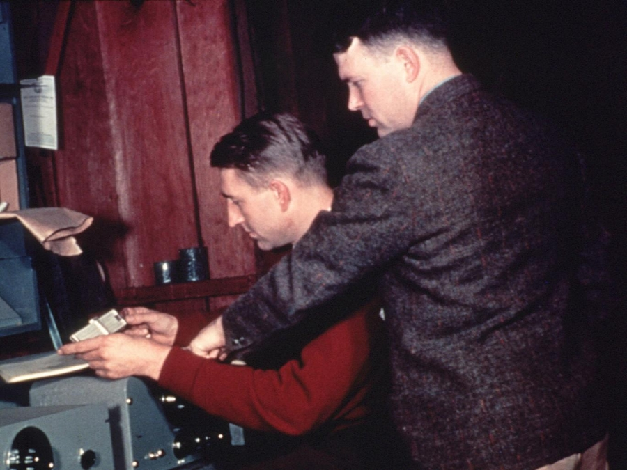 Hewlett-Packard co-founders David Packard (seated) and William Hewlett run final production tests on an audio oscillator. The photo was taken in 1939 in the garage at 367 Addison Avenue, Palo Alto, California, where they began their business.