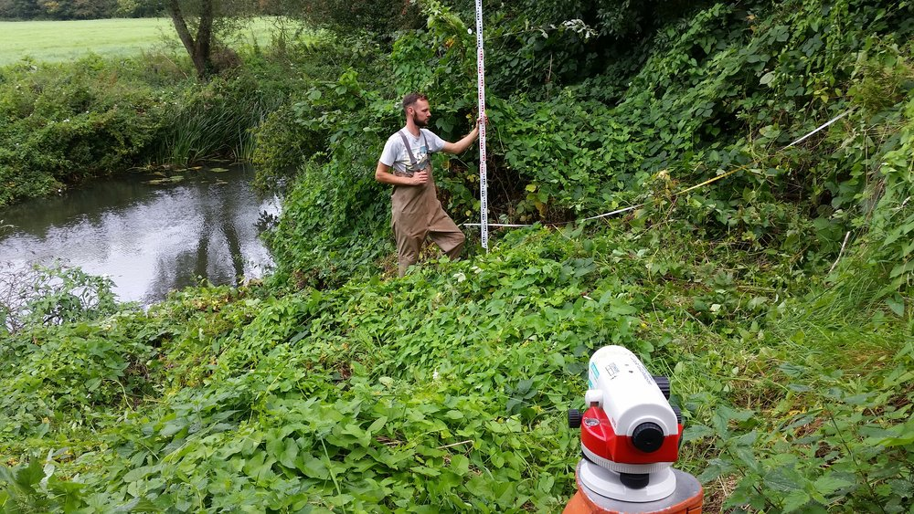 Before works: Undertaking a detailed topographical survey of the River bank.