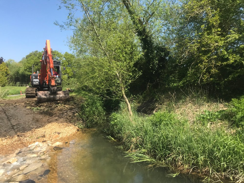 An excavator was used to introduce limestone boulders and gravel to form the new nature like rock ramp fish passage easement.