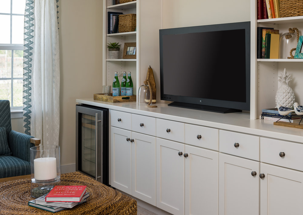 photo of a condominium built in shelving and cabinets