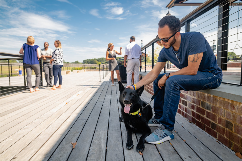 people and a dog enjoying libbie lake pier