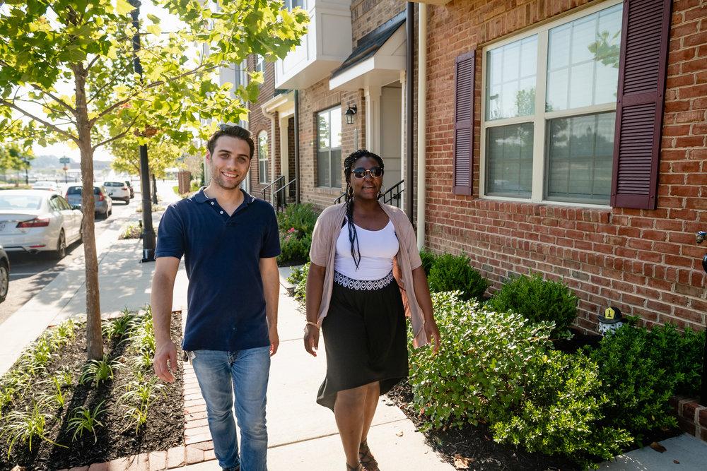 two people walking down the sidewalk in The Neighborhood of Libbie Mill