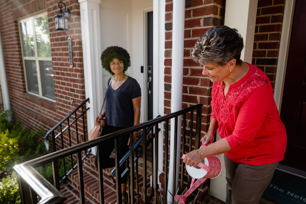 photo of two women greeting each other in The Neighborhood of Libbie Mill Midtown