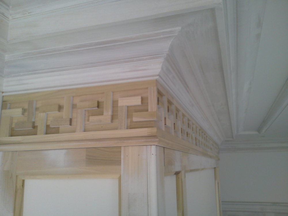 Closeup view of Greek Key Fireplace Surround