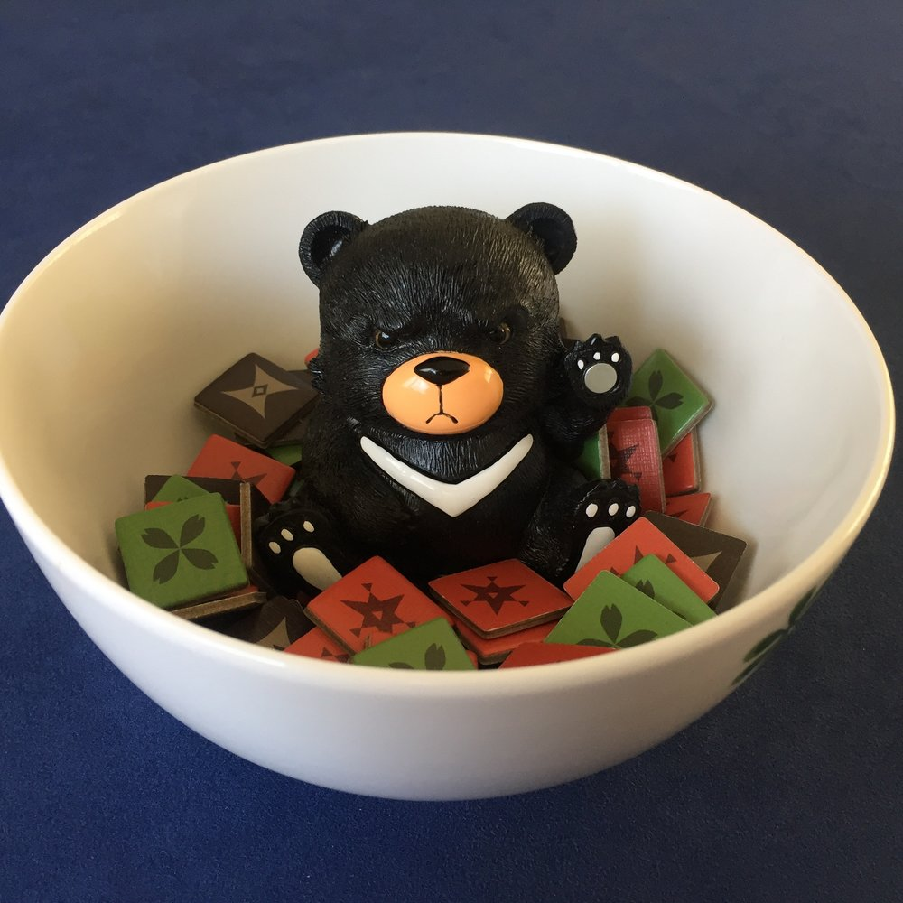 You may want to grab a bowl for your Rune Pieces for ease of play. Black Bear optional.