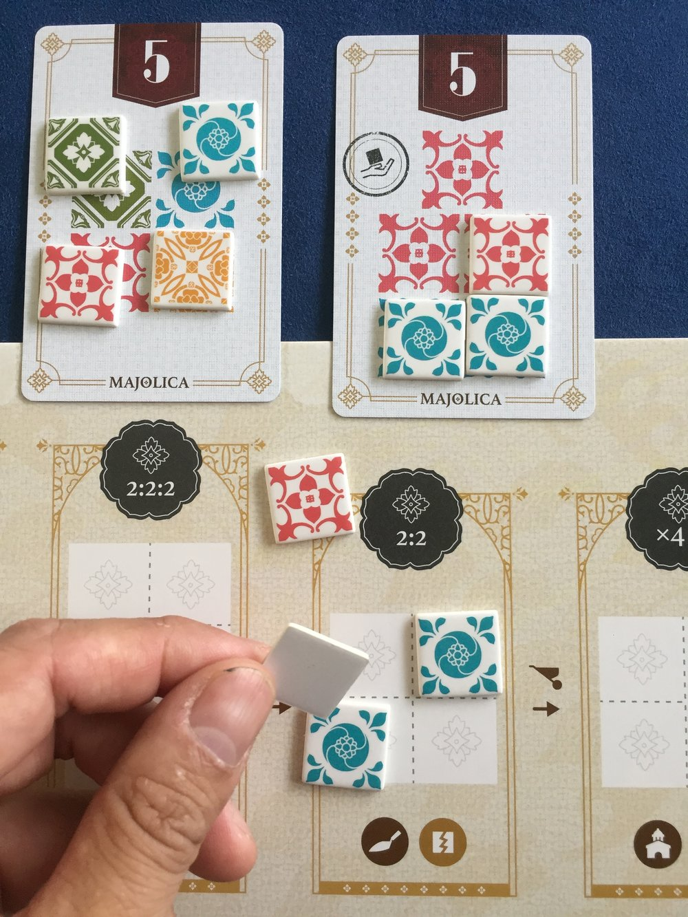 A9.  Push one tile up (dark trowel icon). Destroy one tile (yellow broken tile icon). Push the left over tiles to the right! The combo chain continues!