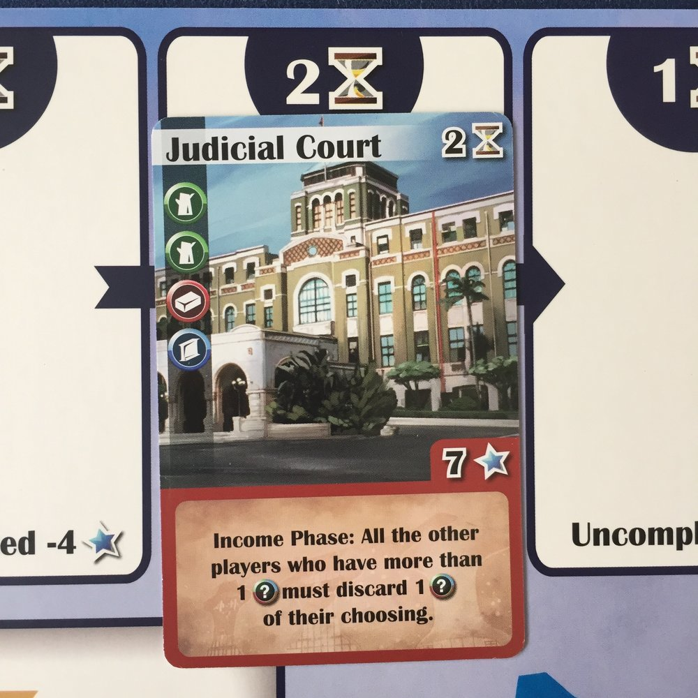The Judicial Court needs 2 turns to construct. After buying it, place it on the 2 hourglass card slot of your player board. Don't forget about the Over Time action!