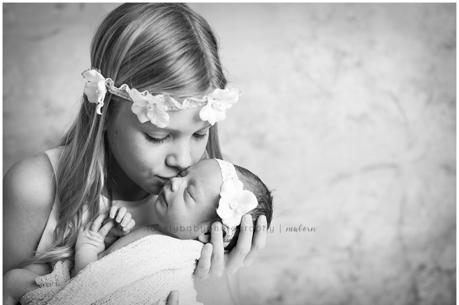 big sister with newborn photography session