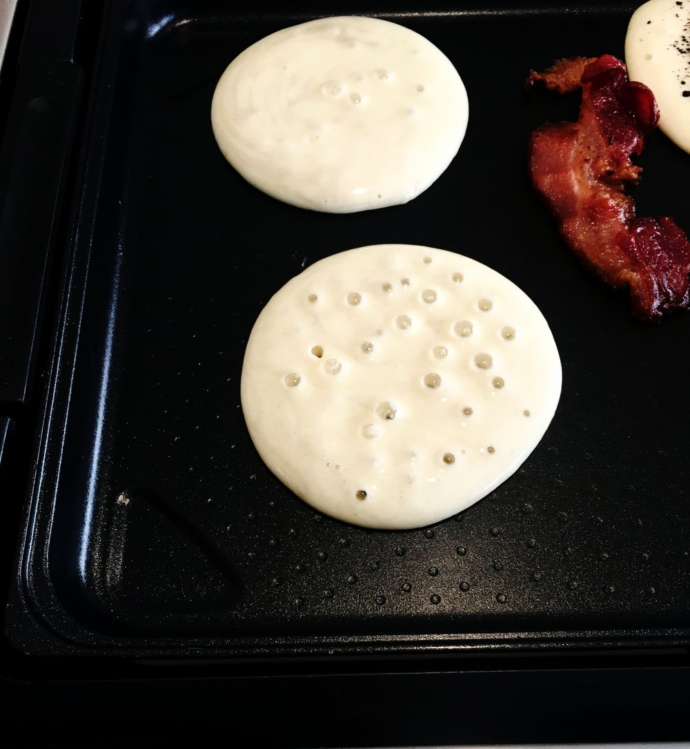 Making Pancakes! Also no you don't cook your own bacon; my brother is very adamant about crispy bacon.