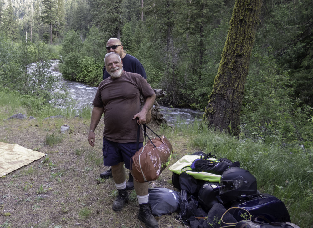 Mark and Leo take up camp at a prime spot next to the river.