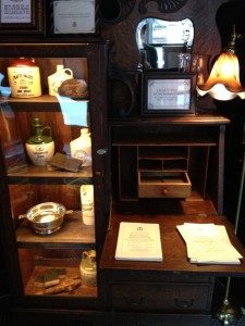 Vintage secretary desk and cabinet in the foyer of the Flatiron Room, NYC.