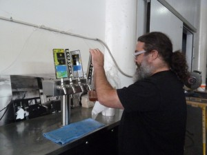 Dave McLean pouring Magnolia beer