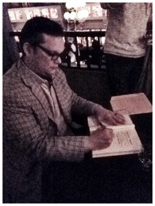 Minnick signing books at the Flatiron Room, NYC.