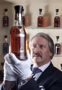 Richard Paterson inspects a bottle at the Harrod's Rare Whisky Room