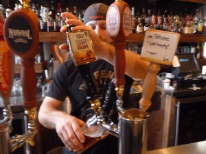 Pouring a pint of NOLA Brewing