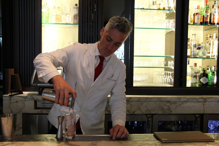 Bartender Pete Stanton pours a cocktail at Bar Fiori, photo courtesy Langham Place Hotels
